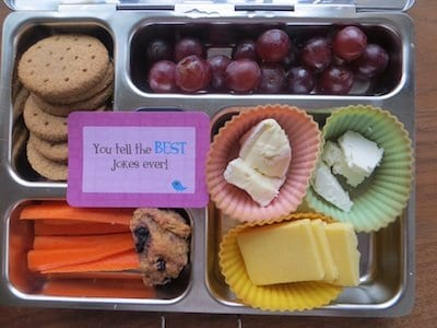 Calcium rich lunchbox: selection of cheeses, ww crackers, grapes, carrot sticks and ww blueberry muffin