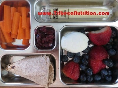Calcium rich lunchbox: cheese stick, boiled egg, ww tortilla, carrots, strawberries, blueberries