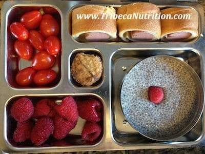 Calcium rich lunchbox: chia seed pudding, pigs in the blanket, tomatoes, raspberries and cookie